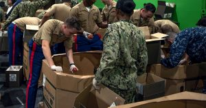 marine sailors volunteer at foodbank