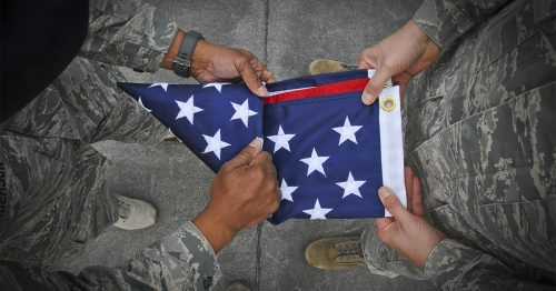 Air National Guardsmen from the 113th Wing, D.C. Air National Guard, fold an American flags at the Air Force Memorial in Arlington, Va., April 11, 2014. A group of approximately 40 service members volunteered to fold flags. In four hours they folded approximately 430 American flags. (left to right) Senior Airman Amanda Feyen, Tech. Sgt. Antonio Lanzo, Airman First Class Cayla Clark, Airman Basic Lindsy Mason, Staff Sgt. Jenna Geronimo and Senior Master Sgt. Susan Clark. (U.S. Air National Guard photo by 1st Lt. Nathan T. Wallin/Released)