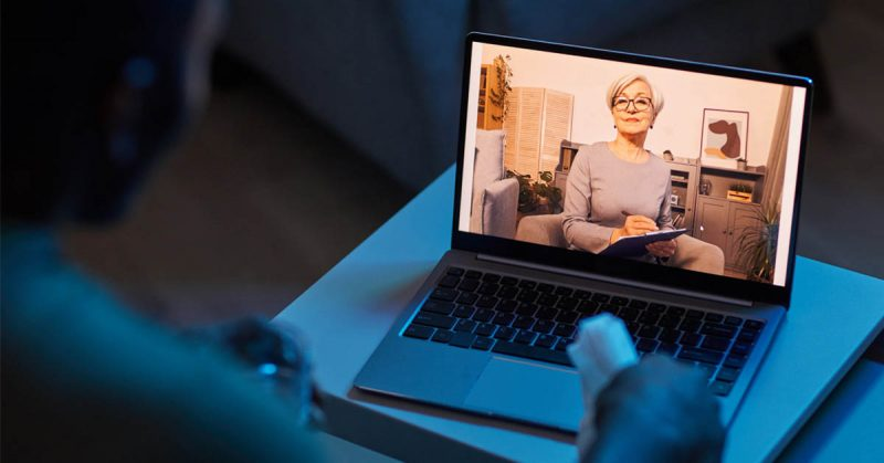 A virtual counseling session on a laptop