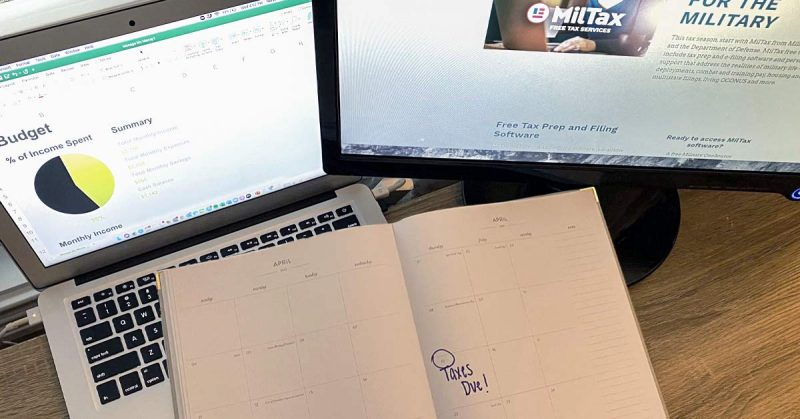 A calendar planner with taxes due circled on tax day