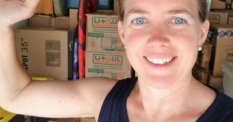Woman smiling in front of moving boxes