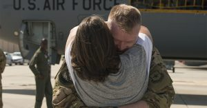 U.S. Air Force Staff Sgt. Jeffrey Sieff, a Boom Operator with the 50th Air Refueling Squadron, embraces his wife Ivy, after returning from a deployment, MacDill Air Force Base, Fla., June 22, 2019.