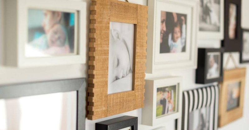 Framed family pictures hanging on the wall