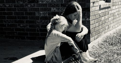 A MilSpouse and her daughter share a quiet moment.