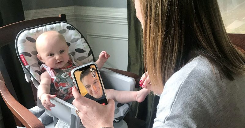 A mother and baby posing with a baby on FaceTime