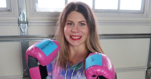 photo of woman with boxing gloves on