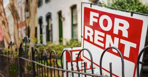 "A closeup of a ""For Rent"" sign"