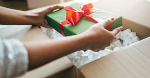 Closeup of a woman holding a wrapped present