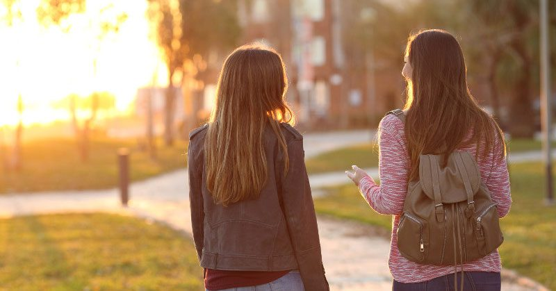Two girls talking outside