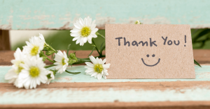 thank you note next to flowers