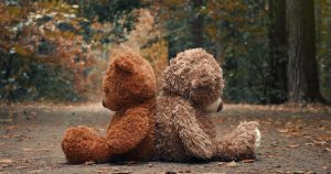 Two giant teddy bears sitting back-to-back