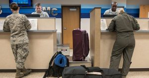 Service members checking in at the airport