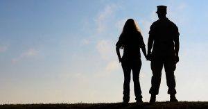 silhouette of military couple