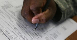 A closeup of a man filling out his tax forms